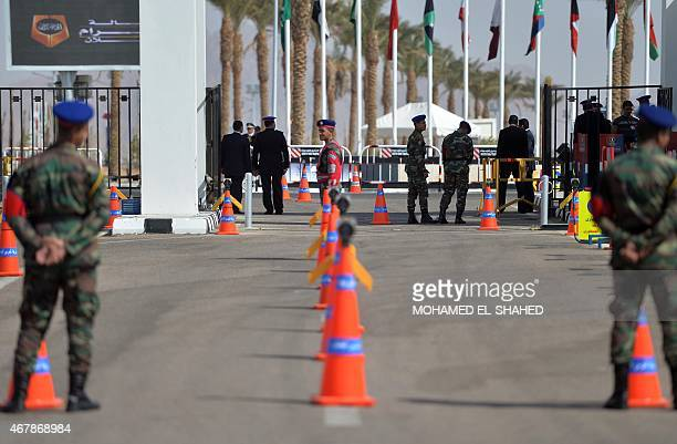 Egyptian security forces stand guard outside the conference hall where the Arab League summit will be held on March 28 in Red Sea resort of Sharm...