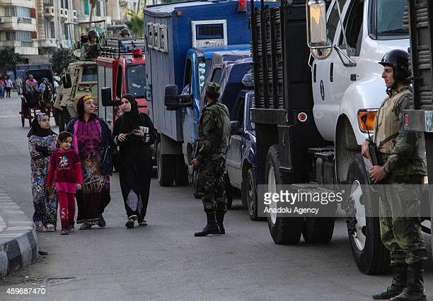 Egyptian security forces take security measures after a group call for an antiregime rally in Alexandria Egypt on November 28 2014