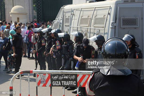Egyptian security forces take security measures as Egyptian students hold an anticoup protest in front of the Cairo University on the second day of...