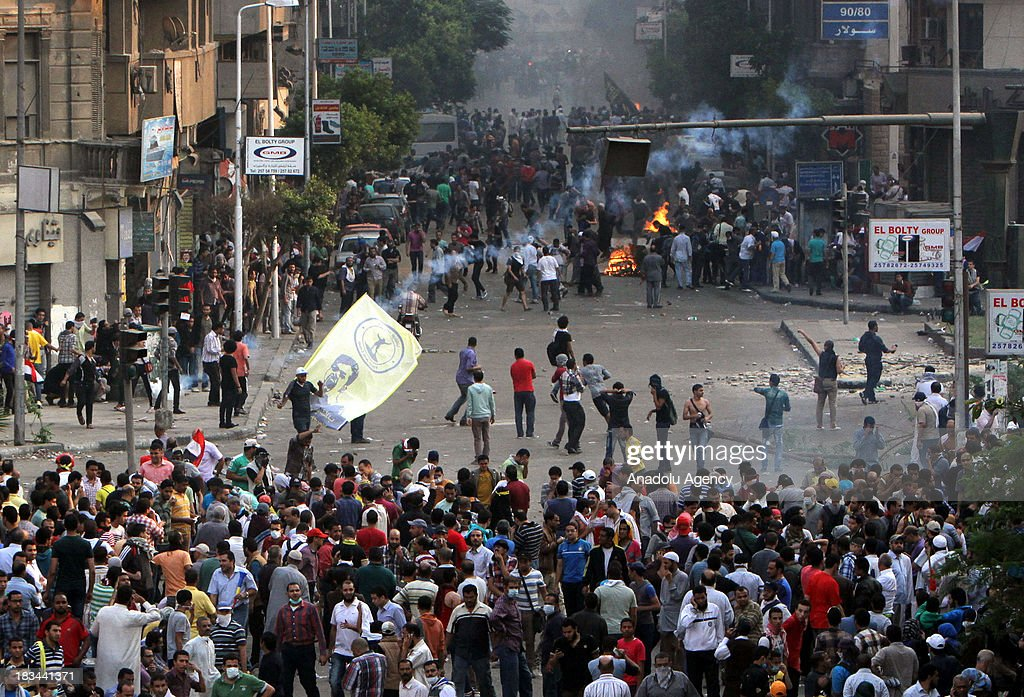 Egyptian security forces use tear gas and plastic bullets to disperse pro-democracy activists during protests marking the 40th anniversary of the 1973 victory over the Israeli army at Ramses Square on October 6, 2013 in Cairo, Egypt. Egypt celebrates the 40th anniversary of the 6th of October War victory against Israel for regaining the Sinai Peninsula.