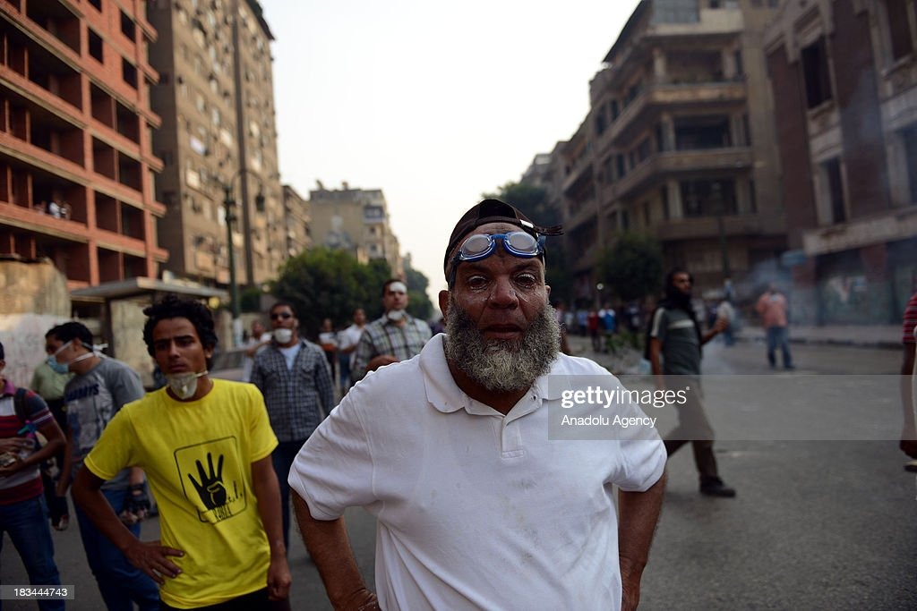 Egyptian security forces use tear gas and plastic bullets to disperse pro-democracy activists who march from Qasr al-Ain Street to Tahrir square during protests marking the 40th anniversary of the 1973 victory over the Israeli army on October 6, 2013 in Cairo, Egypt. Egypt celebrates the 40th anniversary of the 6th of October War victory against Israel for regaining the Sinai Peninsula.