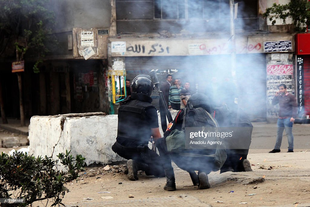 Egyptian security forces use tear gas to disperse protesters during the pro-democracy protests in the Alf Maskan neighborhood of Cairo, Egypt on March 7, 2014. The National Alliance for the Defense of Legitimacy, the main support bloc of Mohamed Morsi, has called for demonstrations under the slogan 'We will not be ruled by the Zionists and Americans.' Pro-democracy preotesters staged on Friday fresh demonstrations in several provinces around the country, kicking off a new week of protests against the military-installed interim government.