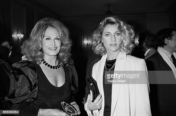 Egyptian singer Dalida and singer Sheila at a party celebrating Herve Vilard's 20 years of singing at Fouquet's in Paris