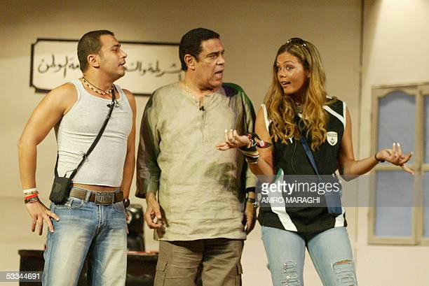 Egyptian singer Emie performs with actors Sami alAdl and Mohammed Nagati on the opening night of the new comedy play In Kiber Ibnak at a movie...