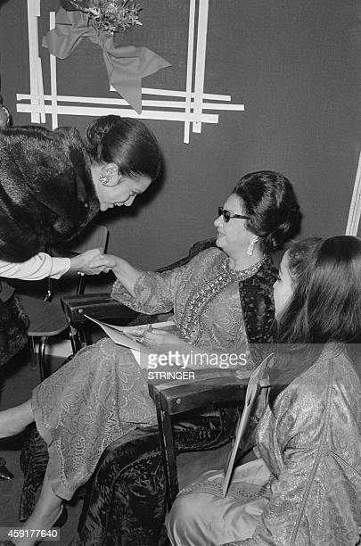Egyptian singer Umm Kulthum is congratulated on November 14 1967 after her concert at the Olympia concert hall in Paris AFP PHOTO