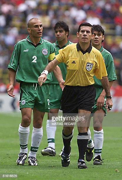 Egyptian soccer players protrest a call by official Ubaldo Aquino of Paraguay during their FIFA Confederation Cup match against Saudi Arabia 29 July...