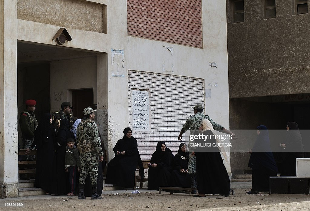 Egyptian soldiers man the entrance to a polling station in President Mohamed Morsi's hometown Adwa in the Nile Delta during a referendum on a new constitution on December 15, 2012. Egypt's opposition cried fraud in the first round of a divisive referendum on a new constitution, accusing Morsi's Muslim Brotherhood of rigging votes to adopt the Islamist-backed text.
