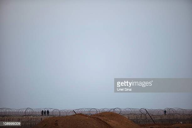 Egyptian soldiers patrol the Egyptian Israeli border on February 10 2011 in Israel Tensions continue to intensify as soldiers patrol the Israel Egypt...