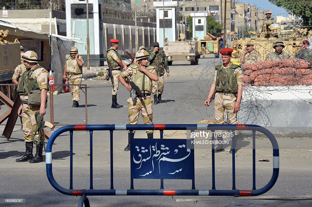 Egyptian soldiers stand guard in front a prison in the Suez Canal city of Port Said following the court verdict over the deadly football riot of 2012...