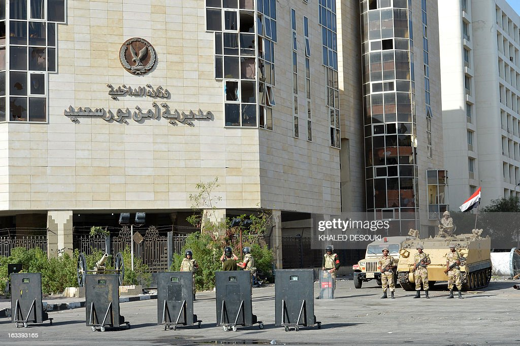 Egyptian soldiers stand guard in front of the Port Said security headquarters following the court verdict over the deadly football riot of 2012 in...