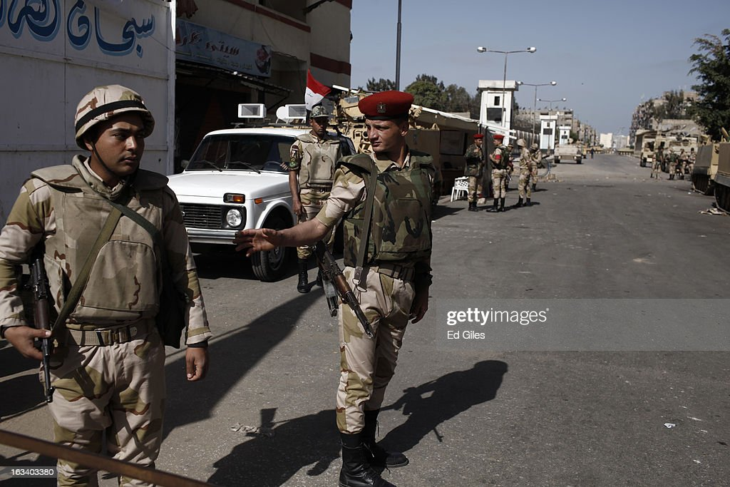 Egyptian soldiers stand guard outside the Port Said prison prior to the announcement of the final verdict in the case of the Port Said football...
