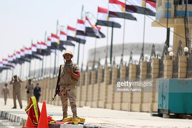 Egyptian soldiers take security measures outside the Tantawi Mosque during the funeral of Egyptian ProsecutorGeneral Hisham Barakat in Cairo Egypt on...