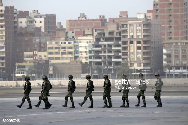 Egyptian special forces soldiers await for Russian President Vladimir Putin' arrival proir the welcoming ceremony at the airport on December 11 2017...