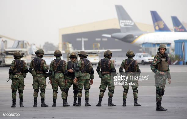Egyptian special forces soldiers awaits for Russian President Vladimir Putin' arrival proir the welcoming ceremony at the airport on December 11 2017...