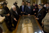 Egyptian state minister of antiquities Zahi Hawass shows one of the pieces damaged by looters and ten repaired at the Egyptian Museum on February 16...