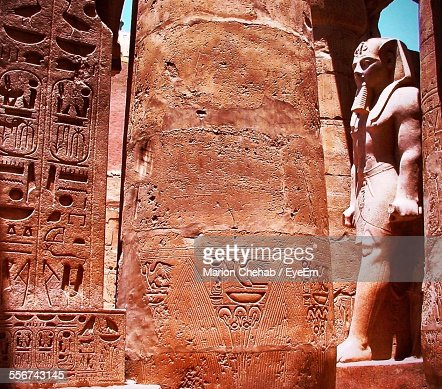 Egyptian Statue And Ornate Column