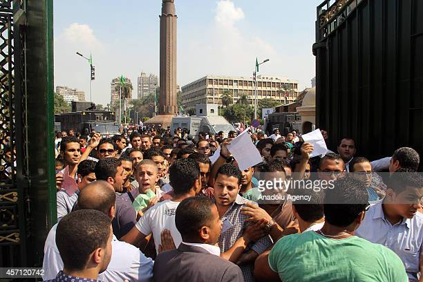 Egyptian students hold an anticoup protest in front of the Cairo University on the second day of the academic year in Cairo Egypt on October 12 2014