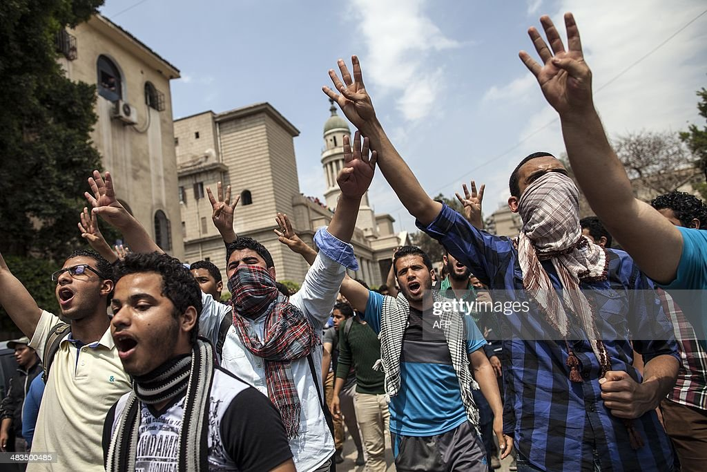 Egyptian students supporters of the Muslim Brotherhood and ousted Islamist president Mohamed Morsi flash the four finger symbol known as 'Rabaa'...
