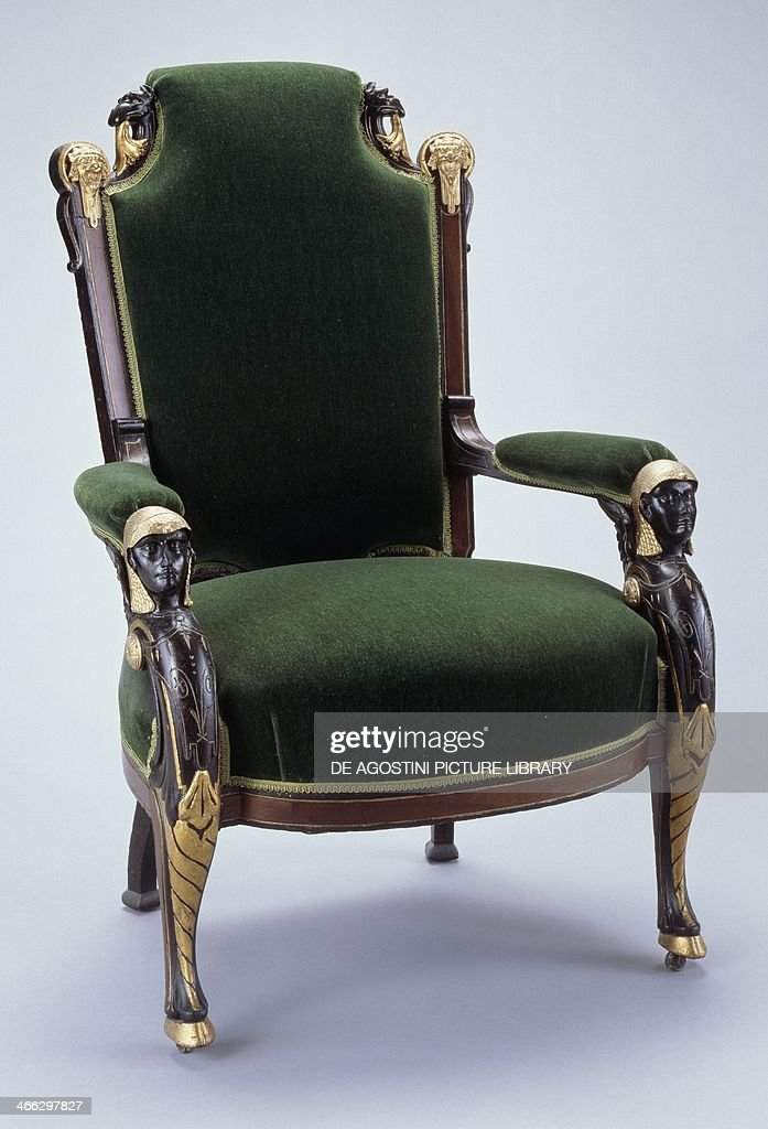Egyptian style ebonized cherrywood and gilt armchair with gilt bronze decoration and upholstered in green velvet. United States of America, second half 19th century.