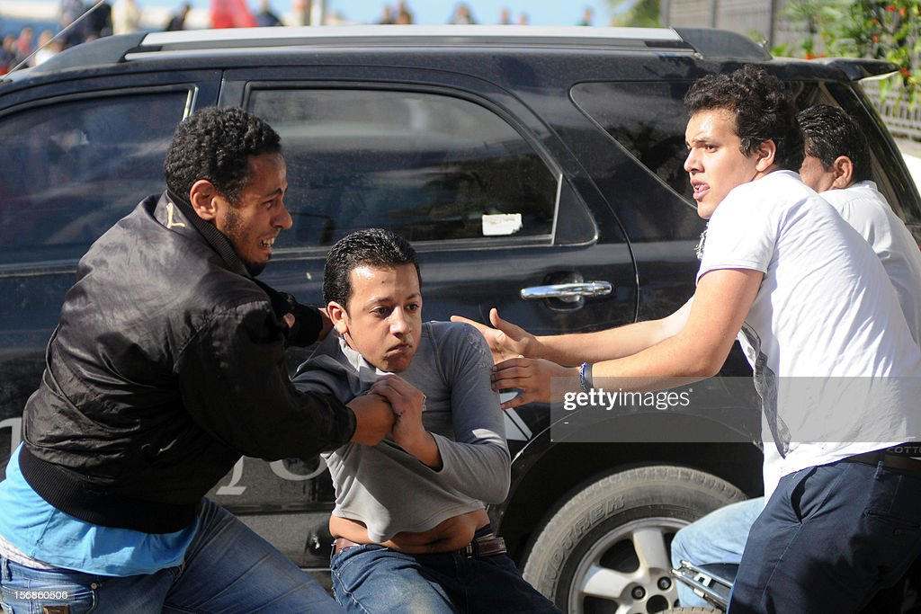 Egyptian supporters and opponents of President Mohamed Morsi clash in the Mediterranean coastal city of Alexandria on November 23, 2012
