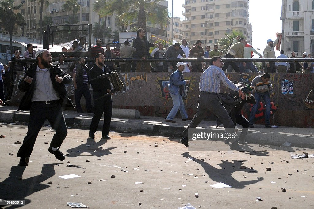 Egyptian supporters and opponents of President Mohamed Morsi clash in the Mediterranean coastal city of Alexandria on November 23, 2012. Opponents set fire to Muslim Brotherhood offices in three Egyptian cities, state television reported, as rival rallies gathered nationwide a day after Morsi assumed sweeping powers.