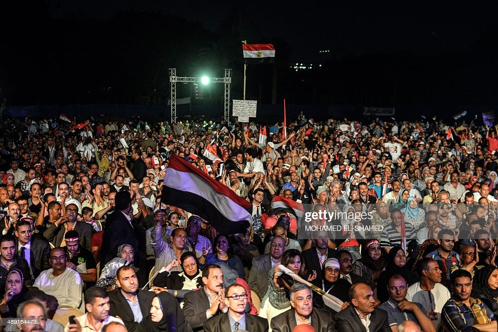 Egyptian supporters of Egypt's former army chief Abdel Fattah al-Sisi attend a gathering in the capital Cairo on May 10, 2014. The retired field marshal, who toppled elected Islamist president Mohamed Morsi in July, is expected to sweep the May 26-27 election.