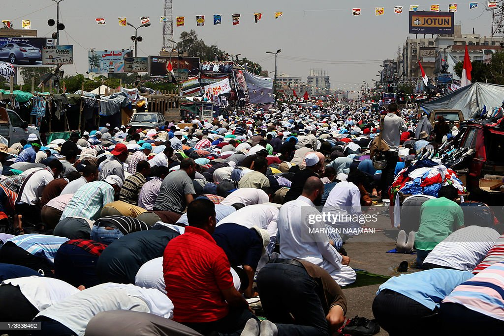 Egyptian supporters of the Muslim Brotherhood and deposed president Mohamed Morsi perform Friday noon prayer outside Cairo's Rabaa al-Adawiya mosque on July 12, 2013. Activists for and against ousted Morsi have called rival rallies for the first Friday of Ramadan, as tensions soar over the army's overthrow of the Islamist leader.