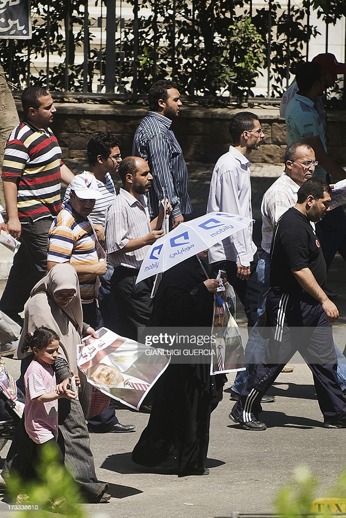 Egyptian supporters of the Muslim Brotherhood and deposed president Mohamed Morsi march towards Cairo's University to stage a sit-in in support with Morsi on July 12, 2013, following Friday noon prayer. Activists for and against ousted Morsi have called rival rallies for the first Friday of Ramadan, as tensions soar over the army's overthrow of the Islamist leader.
