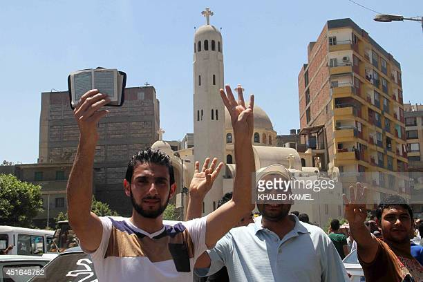 Egyptian supporters of the Muslim Brotherhood movement flash the 'Rabaa' sign during a rally to mark the first anniversary of the military ouster of...
