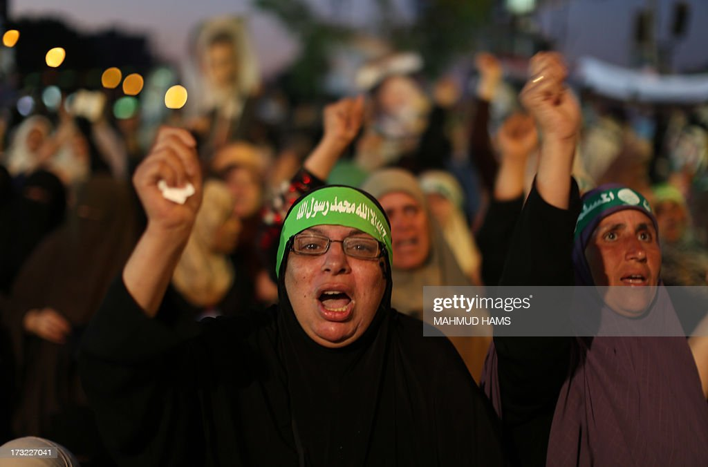 Egyptian supporters of the Muslim Brotherhood shout slogans in favour of Egypt's deposed president Mohamed Morsi after breaking the fast outside Cairo's Rabaa al-Adawiya mosque on July 10, 2013, the first day of Islam's holy month of Ramadan. Tens of millions across the Muslim world fast from dawn to dusk and strive to be more pious and charitable during the month, which ends with the eid holiday.