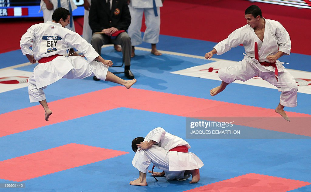 Egyptian team members, Ahmed Shawky (L), Mostafa Ibrahim (C) and Ibrahim Moussa, practice on November 25, 2012 before the men's team kata semi-finals of the Karate world championships at the POPB stadium in Paris.