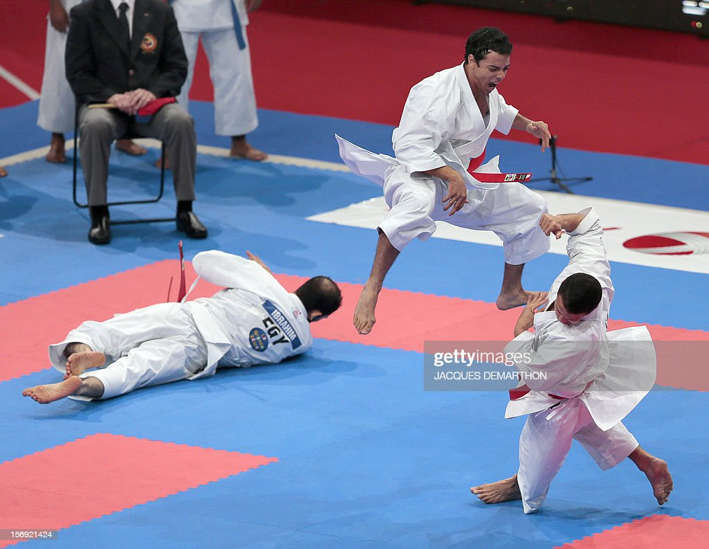 Egyptian team members, Mostafa Ibrahim (L), Ibrahim Moussa (C) and Ahmed Shawky, practice on November 25, 2012 before the men's team kata semi-finals of the Karate world championships at the POPB stadium in Paris.