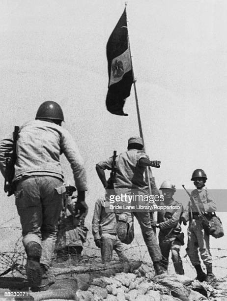 Egyptian troops plant their flag on captured Israeli territory on the Bar Lev Line on the eastern bank of the Suez Canal in an attack codenamed...