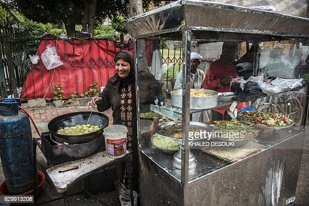 Egyptian Um Adham fries Falafel in a street in the capital Cairo on December 15 2016 / AFP / KHALED DESOUKI