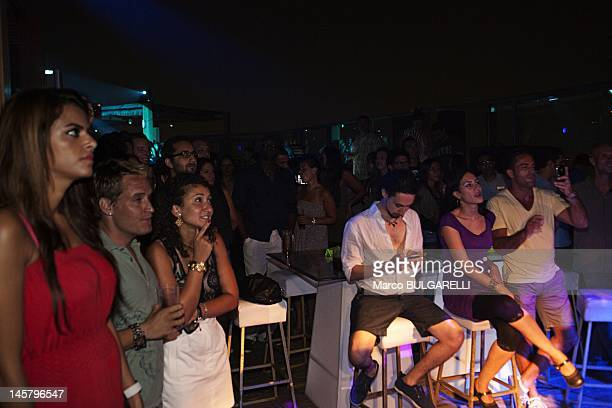 Egyptian upper class party at the Terrace of Nile City Towers some young people watching the barmen making his show on July 20 2011 in Cairo Egypt