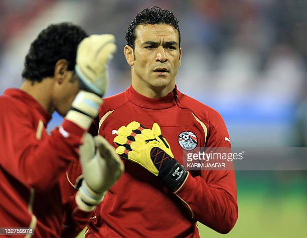 Egyptian veteran goalkeeper Essam ElHadary is seen warming up prior to the start of their international friendly football match againt Brazil in the...