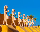 Egyptian warriors statues against the blue sky standing along the route in Sahl Hasheesh area