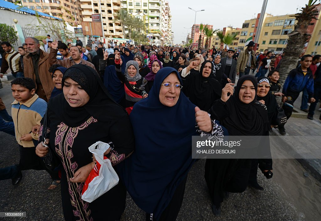 Egyptian women chant slogans as they attend the funeral procession of Abdelhalim Mehana, who was killed during clashes with riot police on March 4, during his funeral in the Suez Canal city of Port Said on March 8, 2013, a day before a court is to issue verdicts over the killing of people in a football riot there.