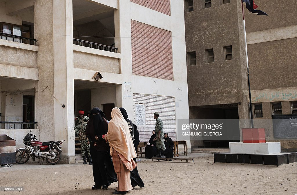 Egyptian women leave a polling station after casting their votes in a referendum on a new constitution in President Mohamed Morsi's hometown Adwa in the Nile Delta on December 15, 2012. Egypt's opposition cried fraud in the first round of a divisive referendum on a new constitution, accusing Morsi's Muslim Brotherhood of rigging votes to adopt the Islamist-backed text.