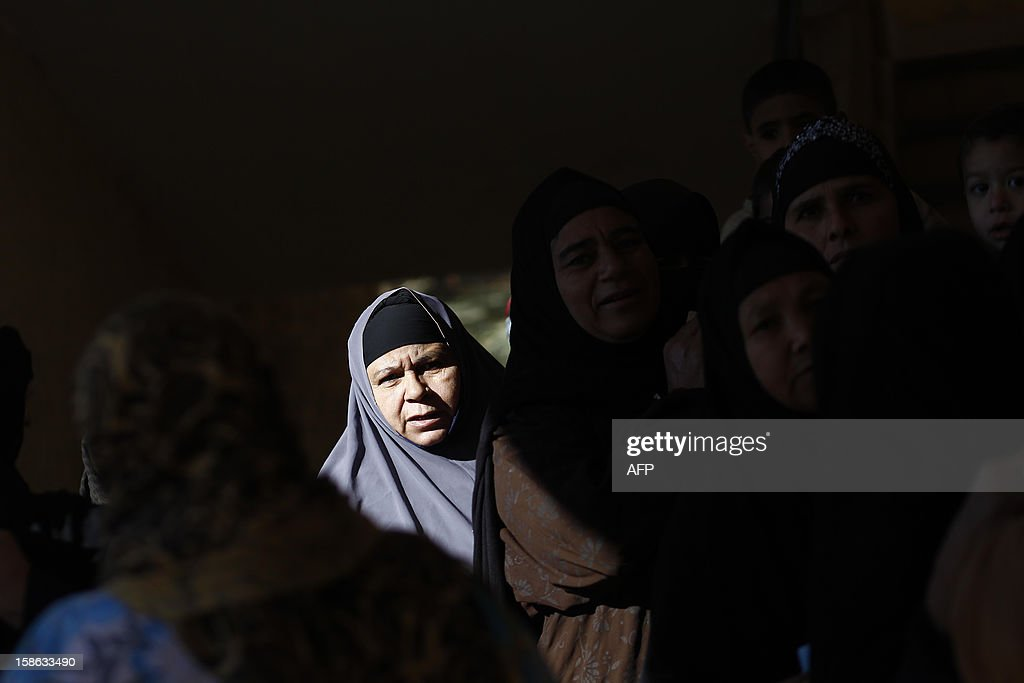 Egyptian women queue at a polling station during the second round of a referendum on a new draft constitution in Beni Sueif, south of Cairo, on December 22, 2012. Egyptians are voting in the final round of a referendum on a new constitution championed by President Mohamed Morsi and his Islamist allies against fierce protests from the secular-leaning opposition. AFP PHOTO/MAHMUD KHALED