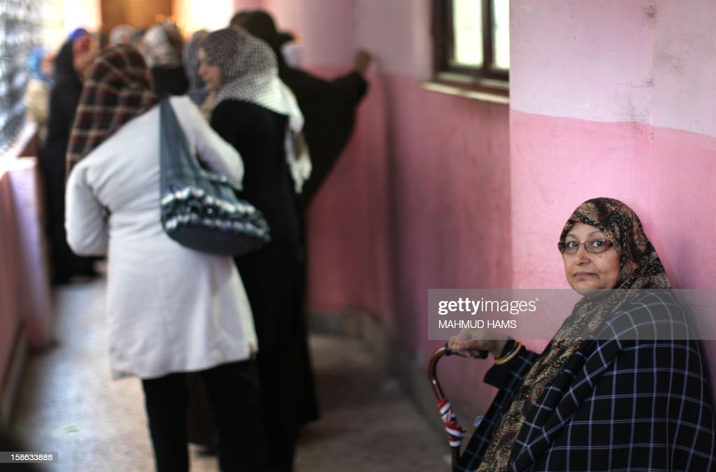Egyptian women queue outside a polling station during the second round of a referendum on a new draft constitution in Giza, south of Cairo, on December 22, 2012. Egyptians are voting in the final round of a referendum on a new constitution championed by President Mohamed Morsi and his Islamist allies against fierce protests from the secular-leaning opposition.