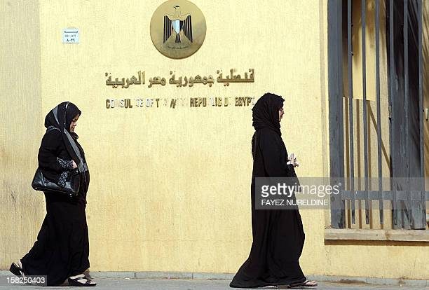 Egyptian women residing in Saudi Arabia arrive at the Egyptian embassy in Riyadh to take part in a vote on a divisive draft constitution in theiron...