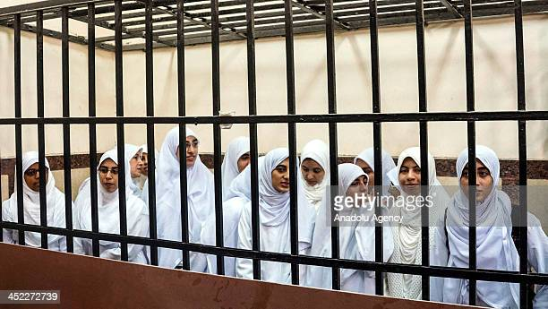 Egyptian women supporters of Mohammed Morsi stand in the courtroom in Alexandria Egypt on November 27 2013 An Egyptian court on Wednesday sentenced...