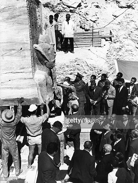 Egyptian workers are laying the first block of the twin temples of Abu Simbel on their new site 26 January 1966 in presence of Aziz Yassin Tourism...