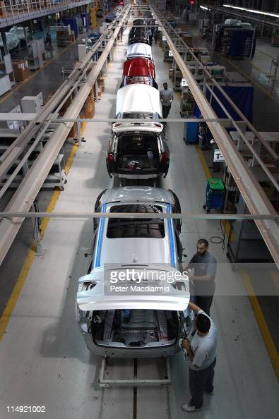 Egyptian workers assemble vehicles at a BMW factory on May 29 2011 in 6th October City Egypt Local workers produce 3000 BMW cars a year Protests in...