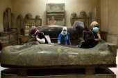 Egyptian workers clean some of the archeological pieces inside the Egyptian Museum on February 16 2011 Looters broke into the museum in Cairo's...