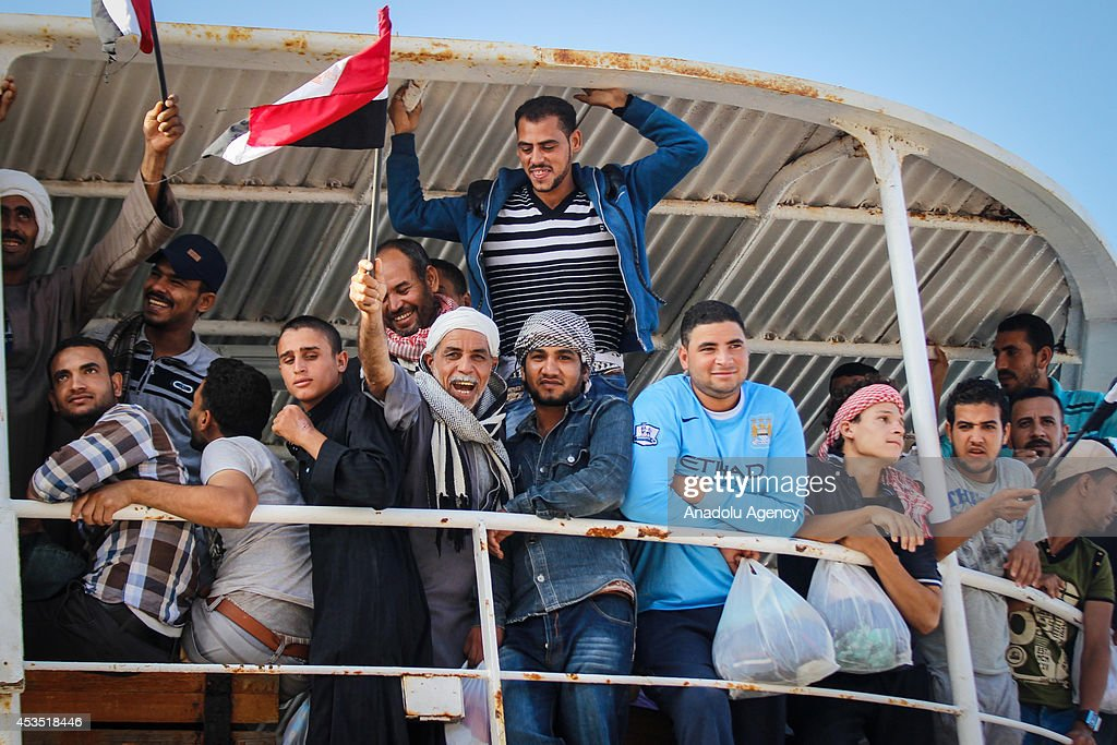 Egyptian workers living in Libya return their home country due to the ongoing clashes between rebels and Libyan armed forces on August 12, 2014 in port city Alexandria of Egypt.