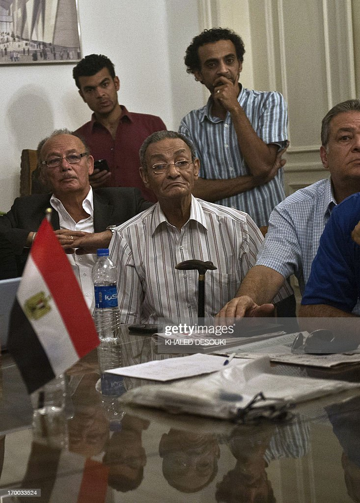 Egyptian writer Bahaa Taher (C) attends a meeting with Egyptian intellectuals during their sit-in at the office of culture minister Alaa Abdelfattah in Cairo on June 6, 2013, calling for his resignation.