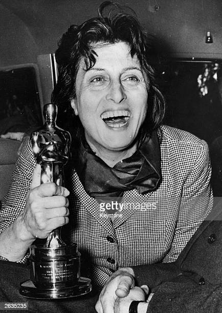 Egyptianborn Italian actress Anna Magnani holding the Oscar she won for her performance in 'Rose Tattoo' presented to her by the US Ambassador Clare...