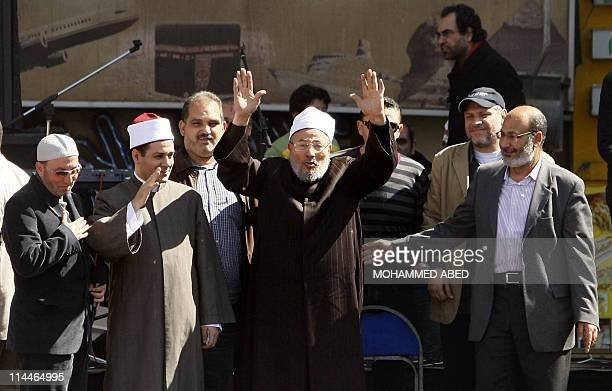 Egyptianborn Muslim cleric Sheikh Yussef alQaradawi greets the crowds as he stands on a stage before delivering the Friday prayer sermon at Cairo's...